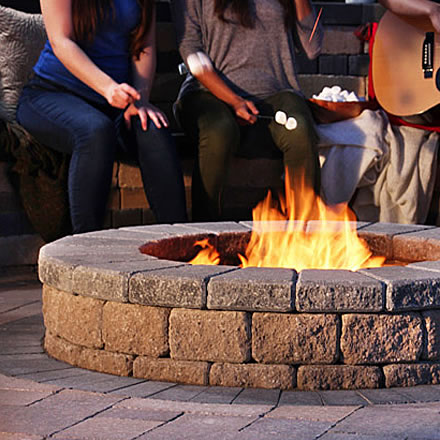 Image of a fire pit featuring Palladio Antico Fire Pit (Beige Mix) and Strada Nova Paver (Beige Mix) products