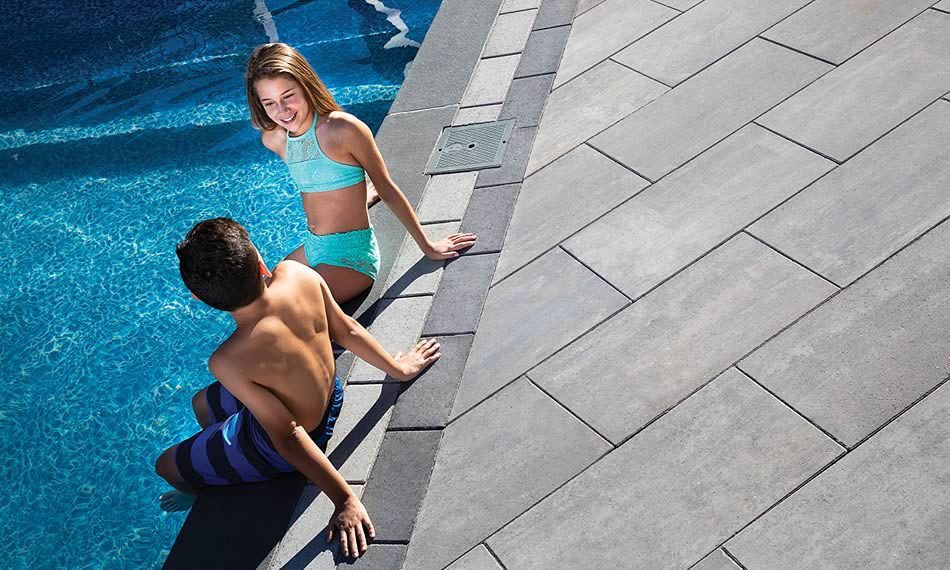 Image of poolside featuring Avari (Glacier Creek) product with Barrollo Round Edge Coping (Ultra Black)