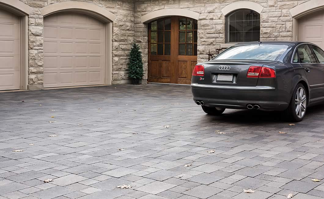 Image of a stone driveway featuring Strada Nova (Grey Mix) product