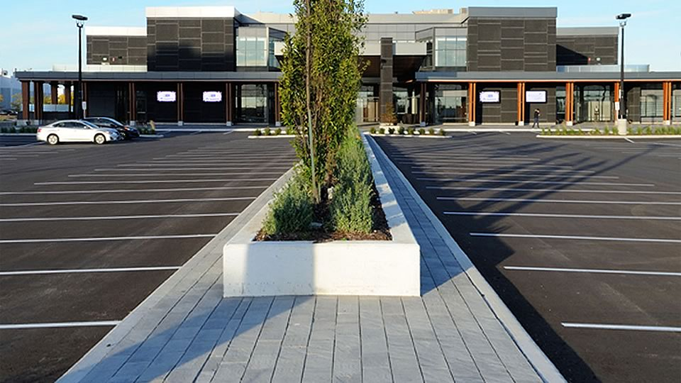 Image of a parking lot garden installation featuring Richmond 80 (Glacier Creek) product