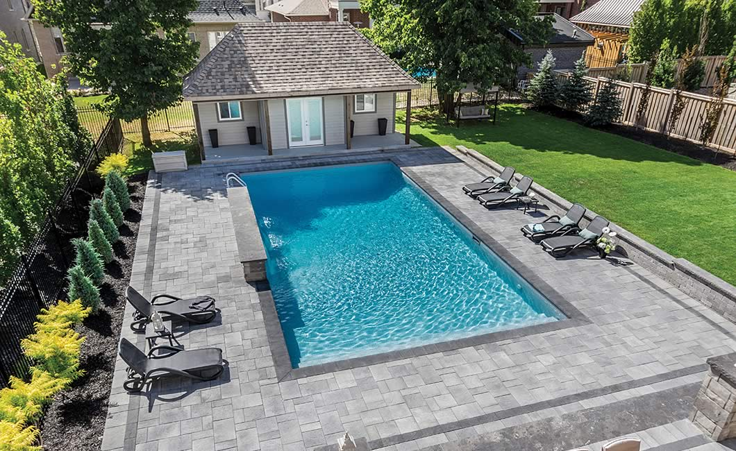 Image of poolside featuring Trevista 50 Textured (Grey Mix) product with Barollo Round Edge Coping (Ultra Black)